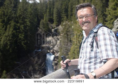 Retired Man Hiking In The Alps