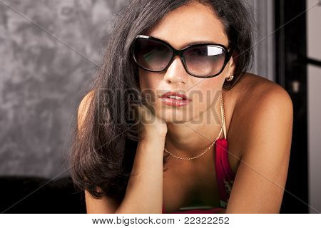 Stylish young girl with elegant sun glasses