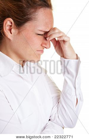 Woman With Migraine Massaging Bridge Of Nose