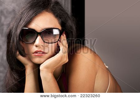 Gorgeous young lady in sun glasses