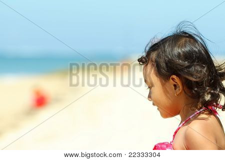Cute Asian Little Girl On The Beach