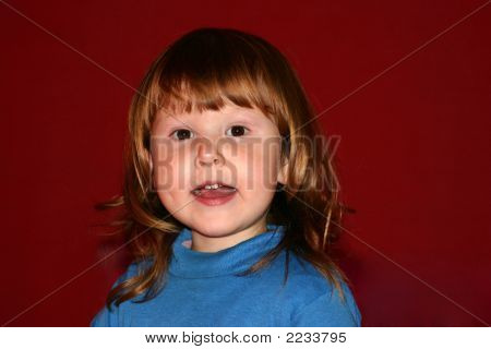 Child Looking Away With Open Mouth