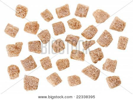 Many Brown Lump Cane Sugar Cubes Isolated On White, Food Background