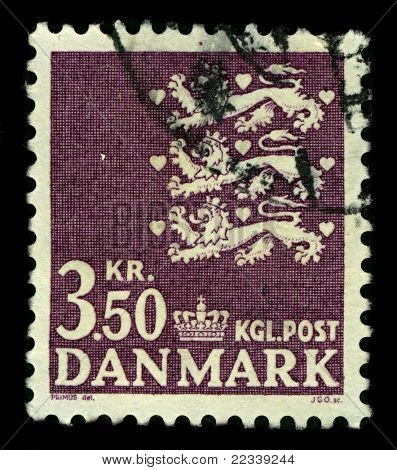 DENMARK-CIRCA 1972:A stamp printed in DENMARK shows image of The national coat of arms of Denmark consists of three crowned blue lions accompanied by nine red hearts,all in a golden shield,circa 1972.