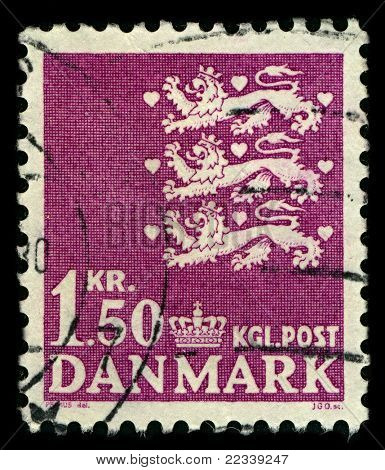 DENMARK-CIRCA 1962:A stamp printed in DENMARK shows image of The national coat of arms of Denmark consists of three crowned blue lions accompanied by nine red hearts,all in a golden shield,circa 1962.