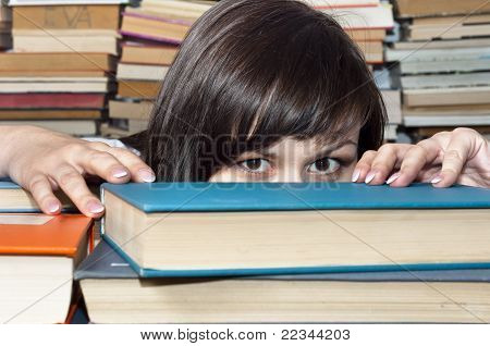 Young Beautiful Student Girl Behind Books