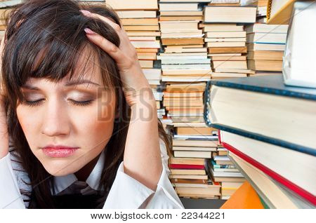 College Girl Holding Her Head Against Many Books
