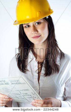 Beautiful Business Woman With Construction Plans