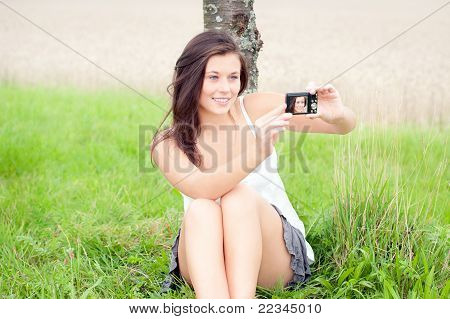 Cute Teen Taking Self-portrait With Digital Camera