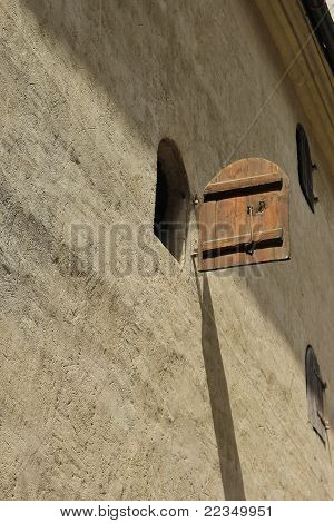 Medieval Wooden Windows In Concrete Wall