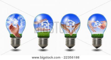 four light bulbs with house inside them