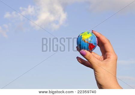 Hand Holding Globe.