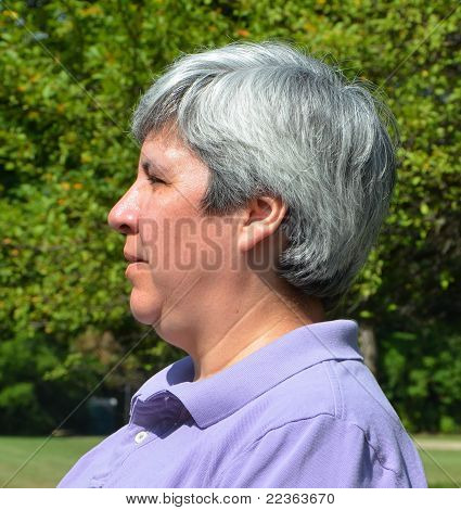 Middle-aged Woman On Bench
