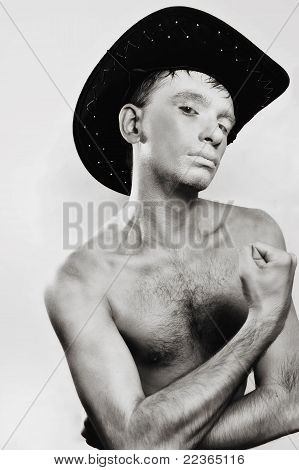 Young Naked Man In Cowboy Hat On White Background