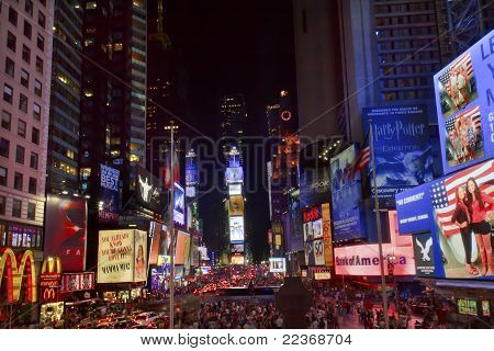 Times Square Lightshow  People Cars New York City Skyline  Night