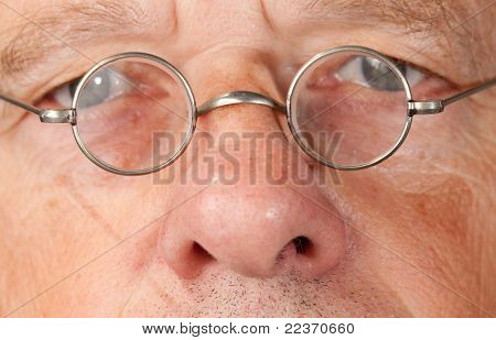 Senior Man With Focus On Glasses
