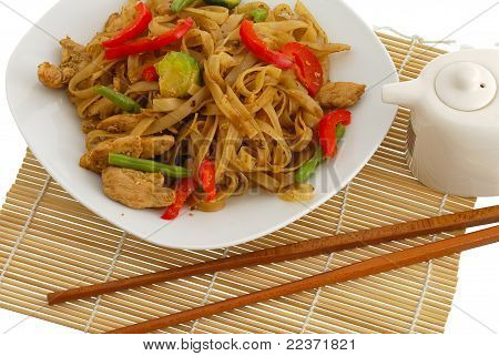 Pad Thai Dish On Straw Pad With Chopsticks
