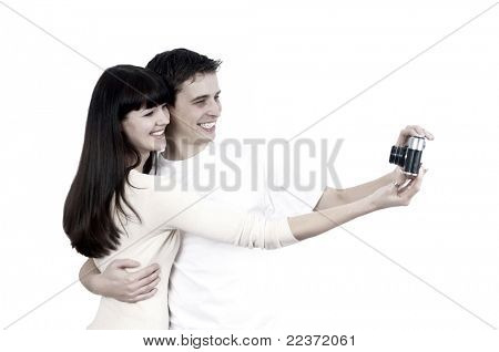 Young beauty couple with photo camera isolated on white background