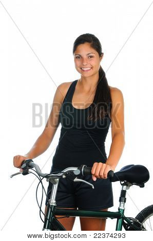 Close up of a smiling young woman standing next to her bicycle with her hands on the handle bars. Vertical format isolated on white.