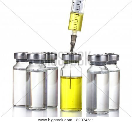 medical ampoules and syringe isolated on white