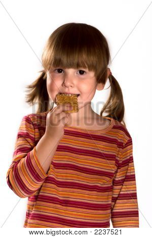 Little Girl Eating Cookie