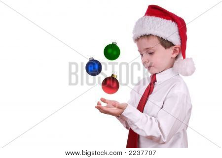 Boy In Christmas Hat With Ornaments