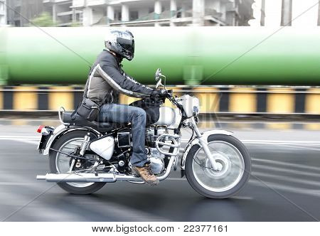 Motorcyclist Riding Through Industrial Zone