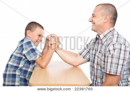 Father And Son Having Fun With Arm Wrestling