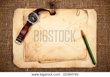 Old Papers And Wristwatch