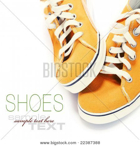 orange sport shoes over white (with sample text)