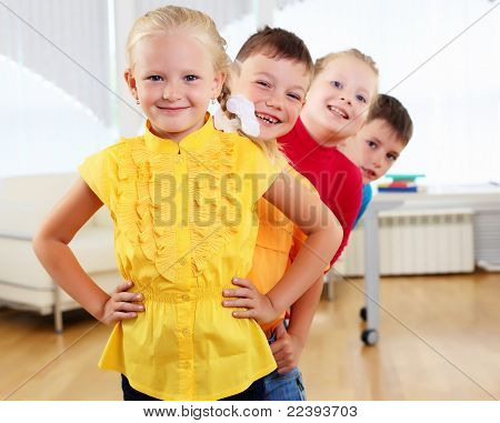 Group classmates standing in a row
