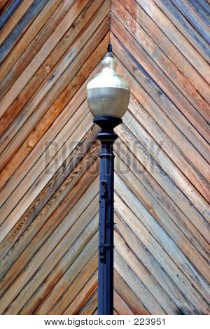 Lamp Post In Front Of Wooden Wall