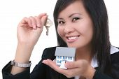 picture of clientele  - A real estate woman holding a key and house - JPG