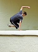 foto of parkour  - an image with intentional motion blur of a young male doing parkour  - JPG