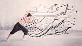 A beautiful young hip hop dancer dancing contemporary street dance in front of urban grey wall backg poster