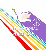 Greeting card with cut out paper flying dove, peace symbol and rainbow for International Peace day.  poster