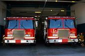 stock photo of fire-station  - Fire station and two fire trucks ready for actions - JPG