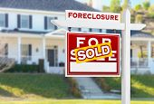 Left Facing Foreclosure Sold For Sale Real Estate Sign in Front of House. poster