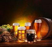 stock photo of beer mug  - Still Life with a keg of beer and draft beer by the glass - JPG