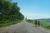 countryside road and young villagers