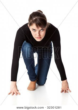 Concentrated woman is getting ready to run. Isolated on a white background