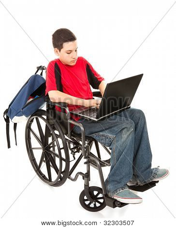 Disabled teen boy using a laptop computer.  Full body isolated on white.