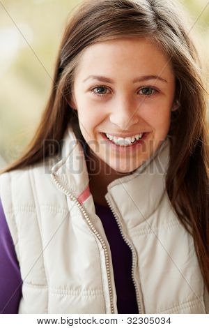 Outdoor Portrait Of Teenage Girl Wearing Winter Clothes