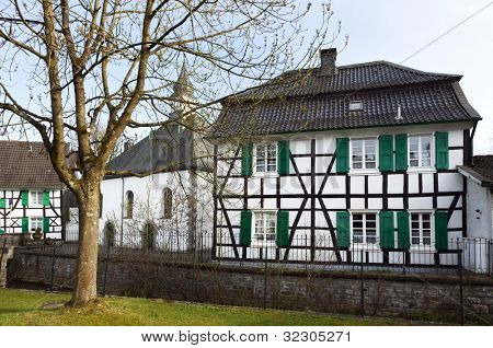 Small church and half-timbered house at Haan-Gruiten, Bergisches Land
