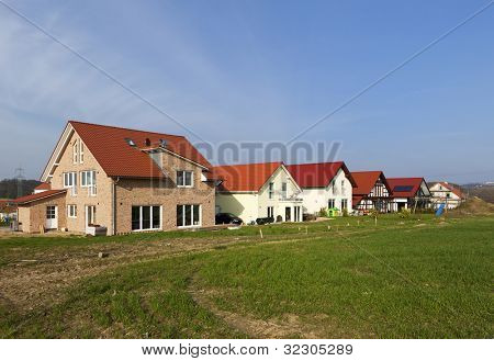 Row of newly built family homes, partially still under construction