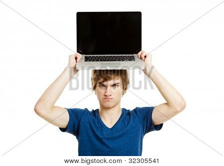 Handsome young man holding a laptop isolated over a white background