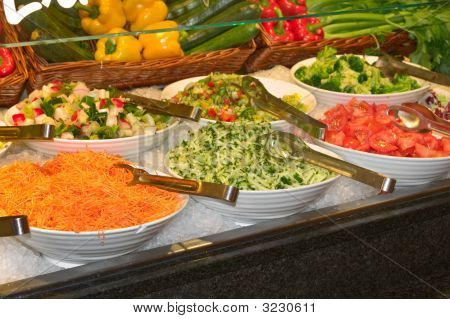 Salad Bar With Fresh Vegetables On Ice Closeup