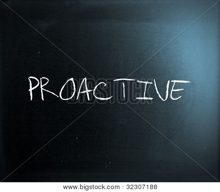 'proactive' Handwritten With White Chalk On A Blackboard