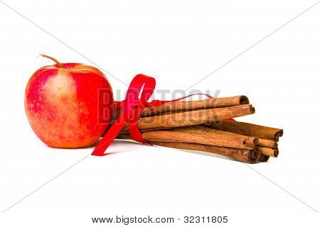 Composition of spices with cinnamon sticks isolated on white background