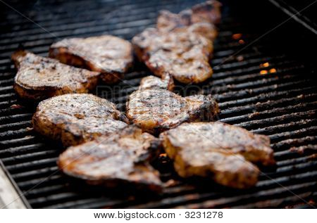 Juicy Pork Chops On A Grill